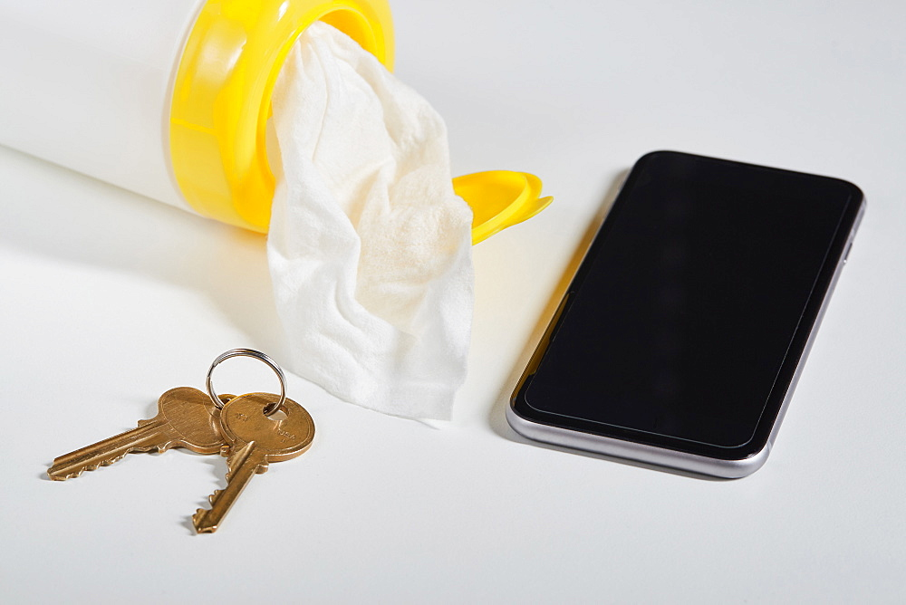 Disinfectant wipes, smart phone and keys