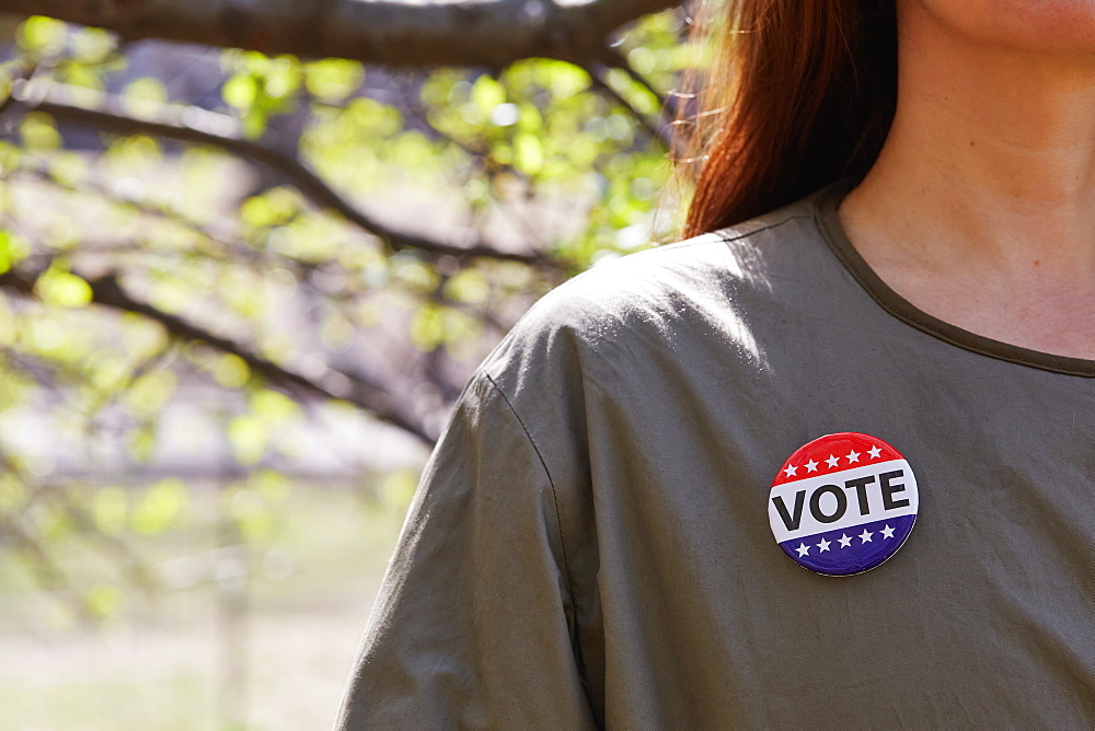 Woman with vote button on her top