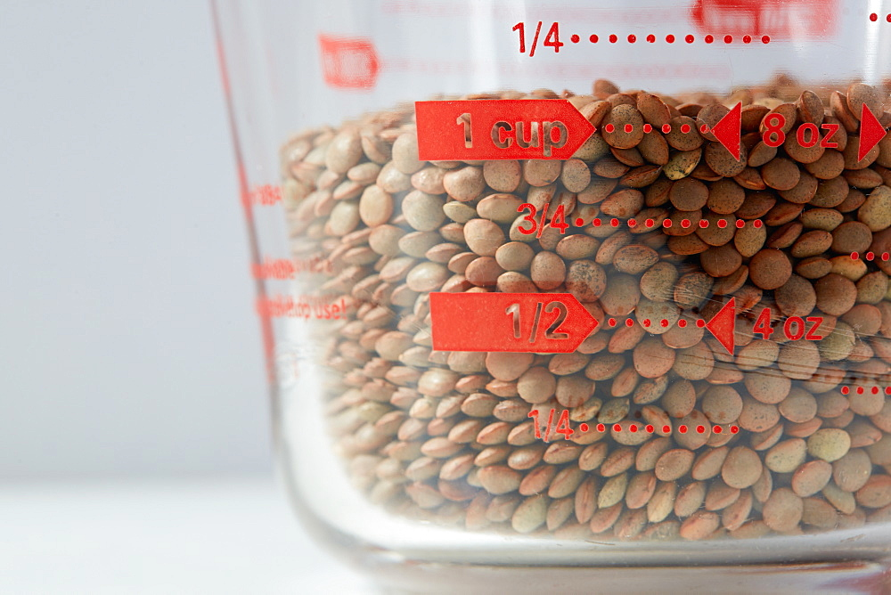 Lentils in measuring cup