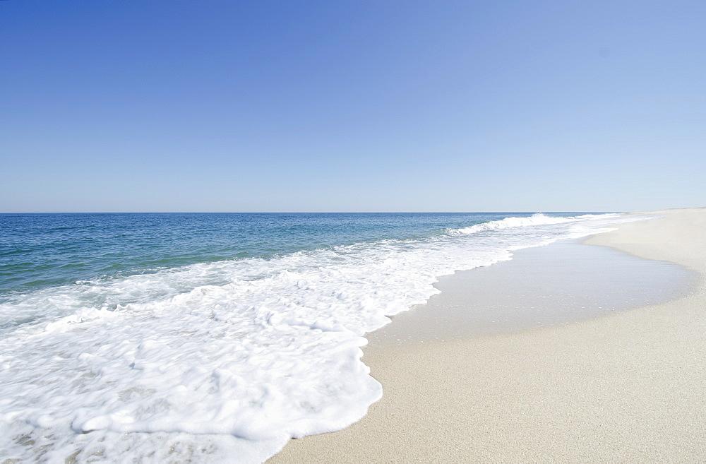 Beach under blue sky