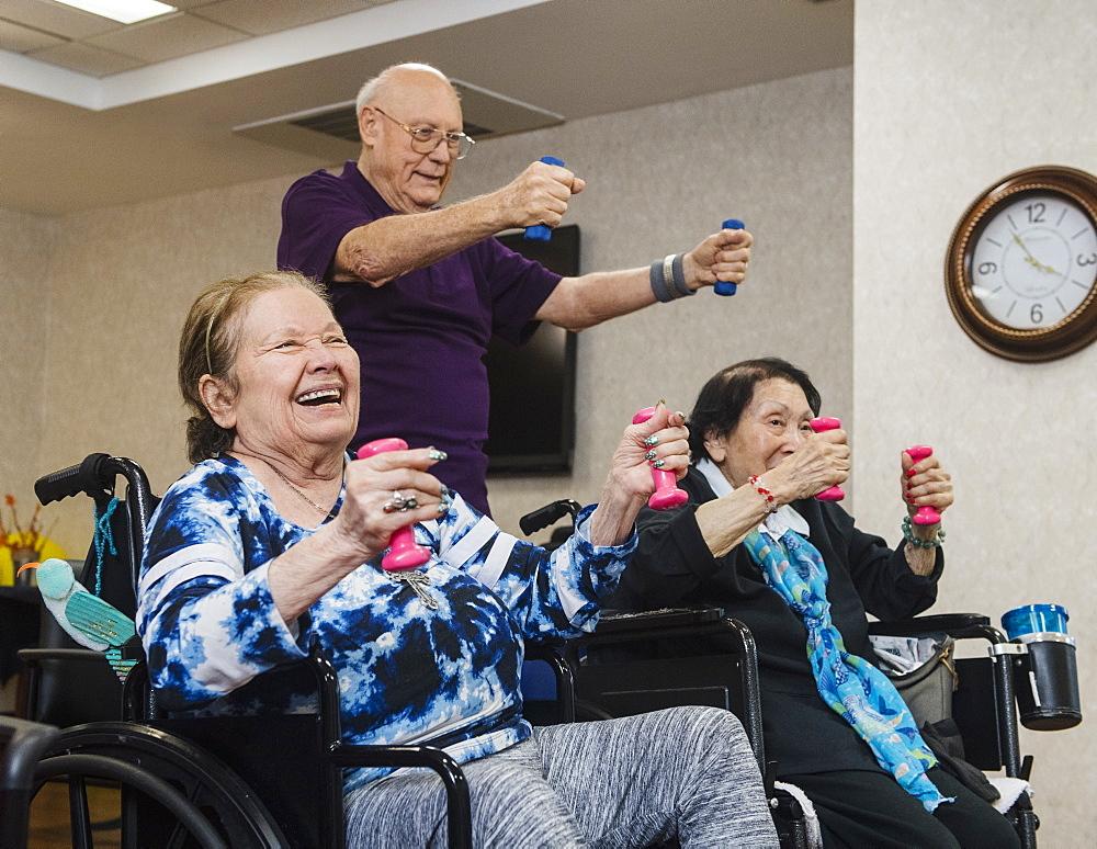 Smiling senior people exercising