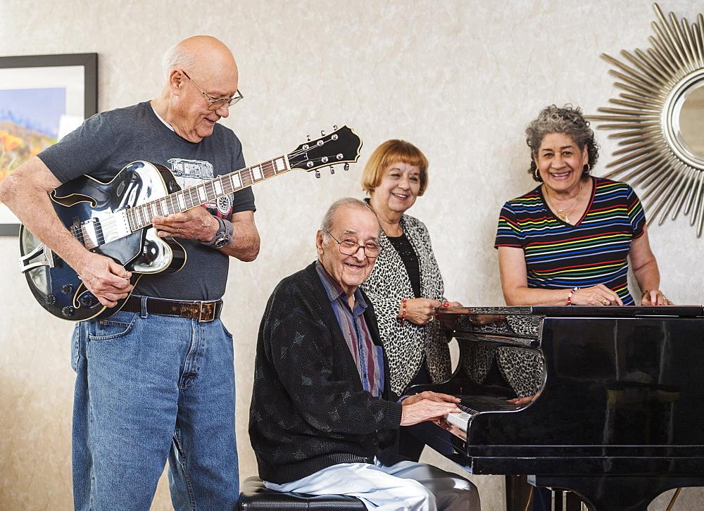 Smiling senior people playing instruments