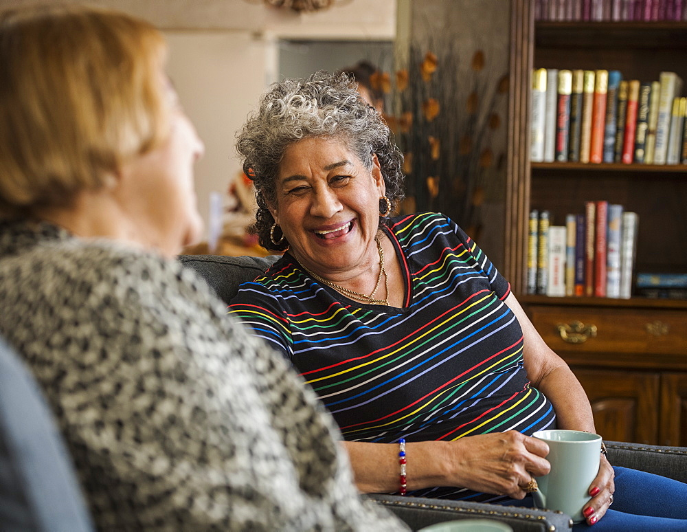 Smiling senior woman holding cup