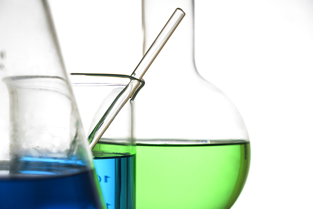 Blue and green liquid in beakers