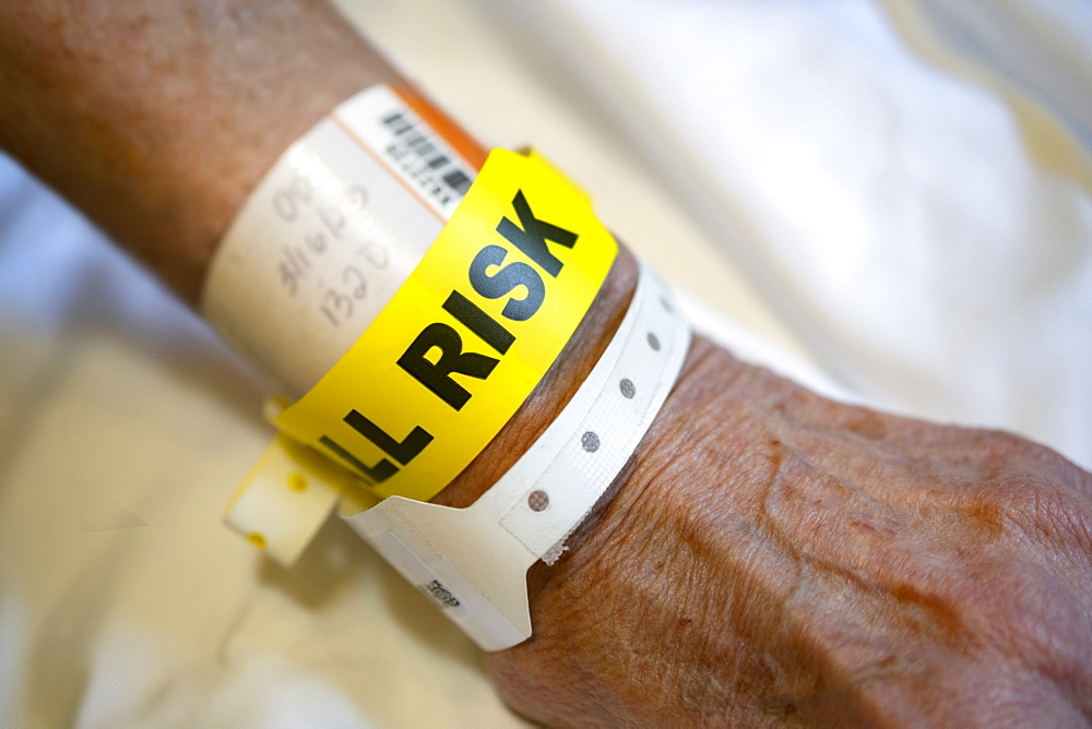 'Fall risk' tag around senior person's wrist