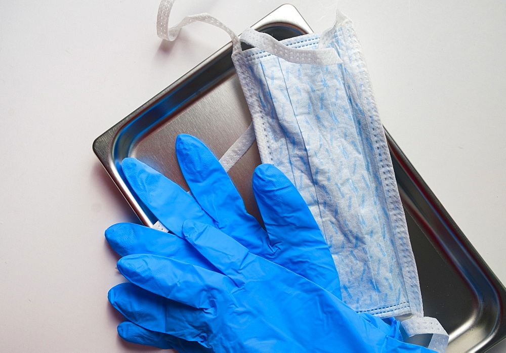 Latex gloves and hygiene mask on tray