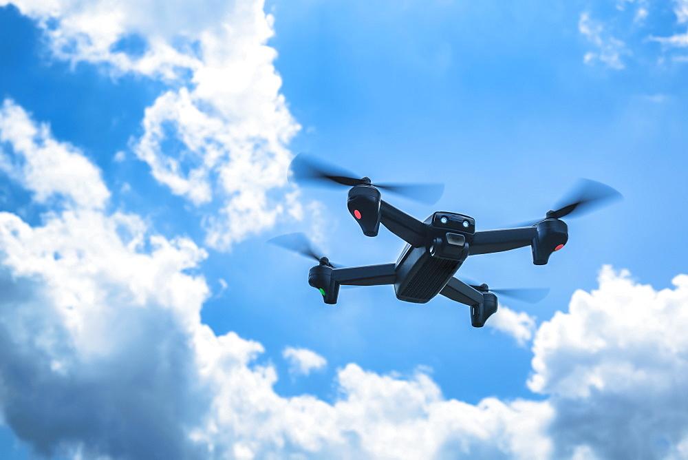 Drone flying in sky