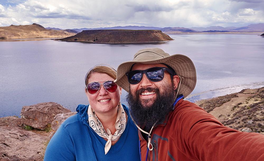 Peru, Sillustani, Portrait of couple by lake