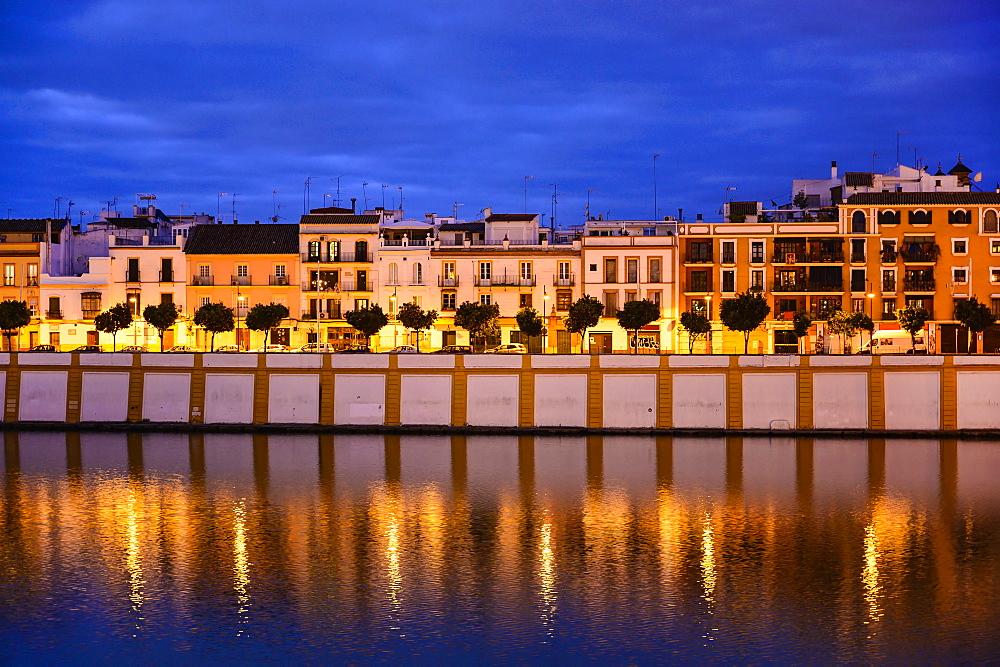 Spain, Seville, Triana, Triana neighborhood reflecting in Guadalquivir River