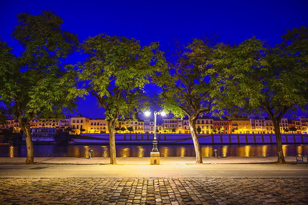 Spain, Andalusia, Seville, Guadalquivir River at night