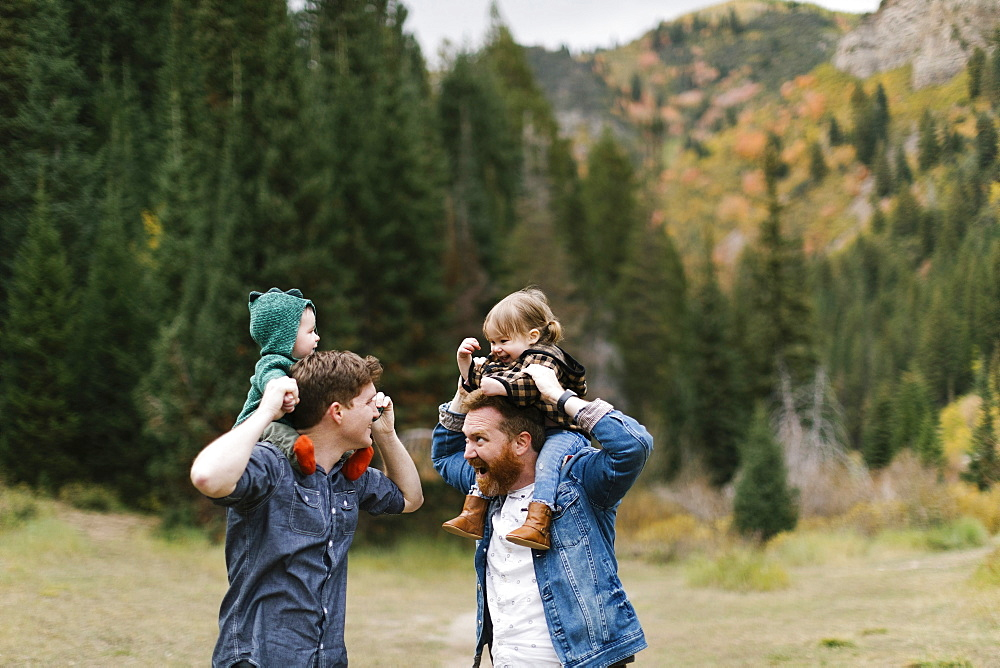 USA, Utah, Salt Lake City, Fathers with children (12-17 months) on shoulders