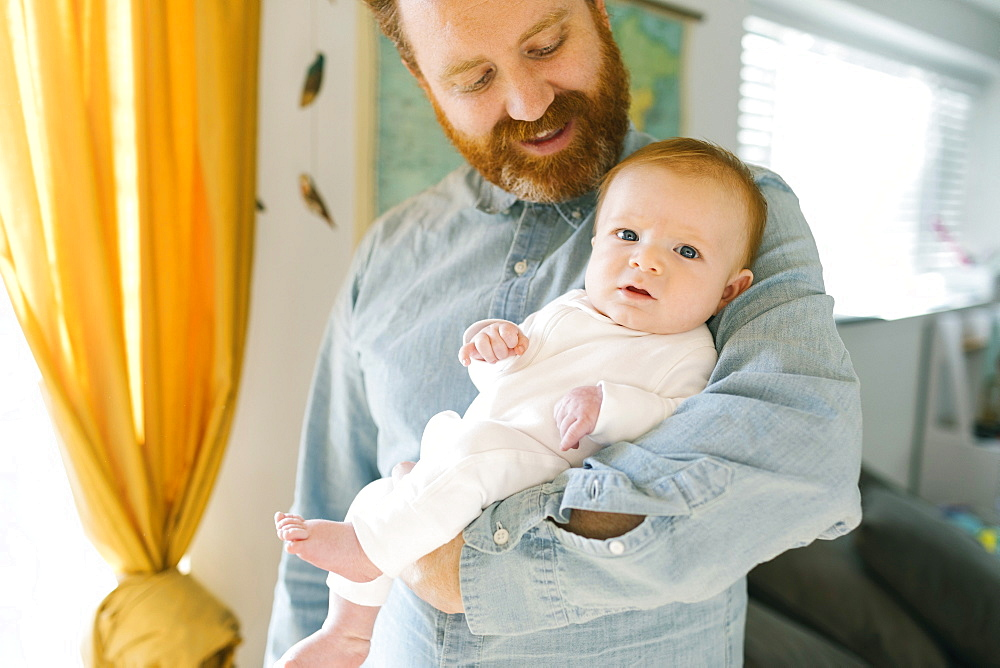 Father holding baby boy (2-3 months)