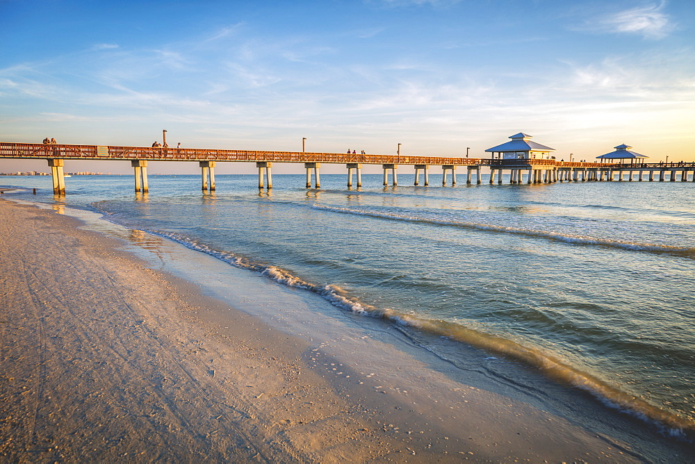 USA, Florida, Fort Myers Beach, Pier in sea at sunset