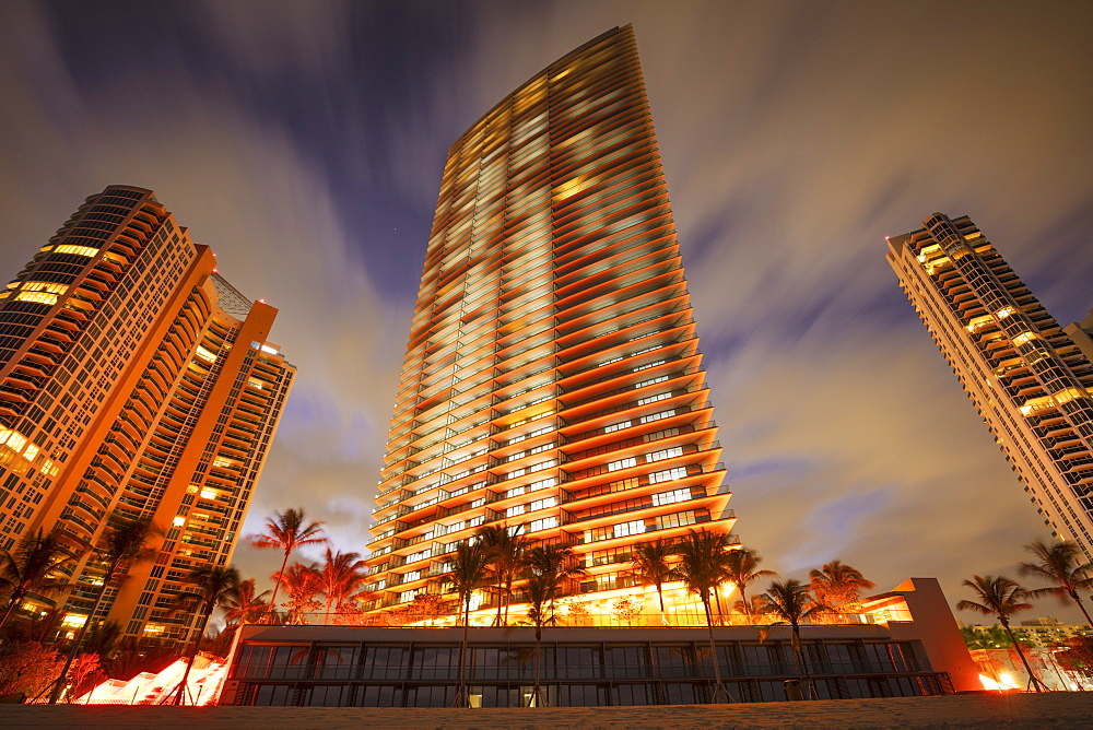 USA, Florida, Miami, Illuminated skyscrapers at beach
