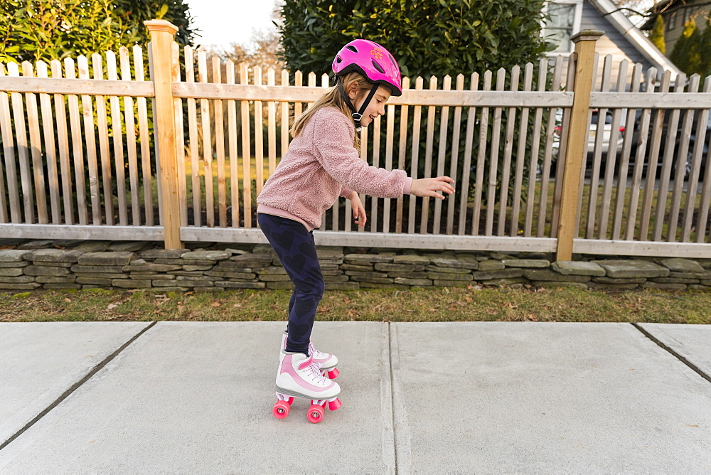 Girl learning how to rollerskate