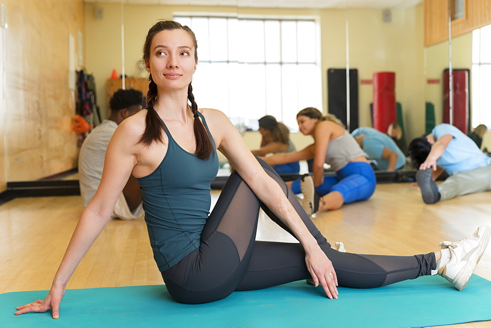 Woman stretching before yoga class