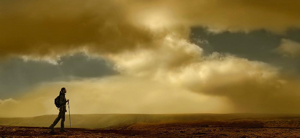 United Kingdom, Scotland, Lone hiker walking in mountains