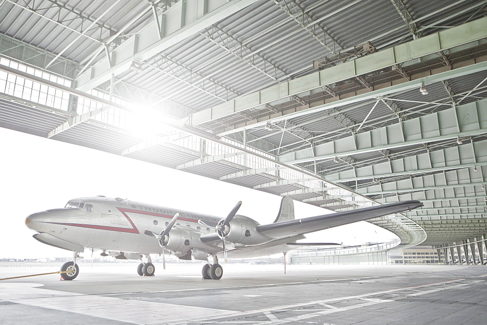 Germany, Berlin, Small airplane in hangar at Tempelhof Airport
