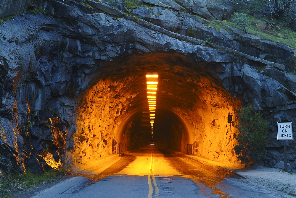 USA, Illuminated tunnel in mountains