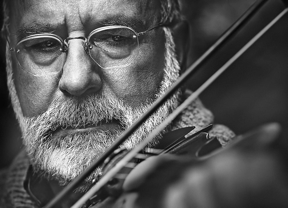 Mature man playing violin