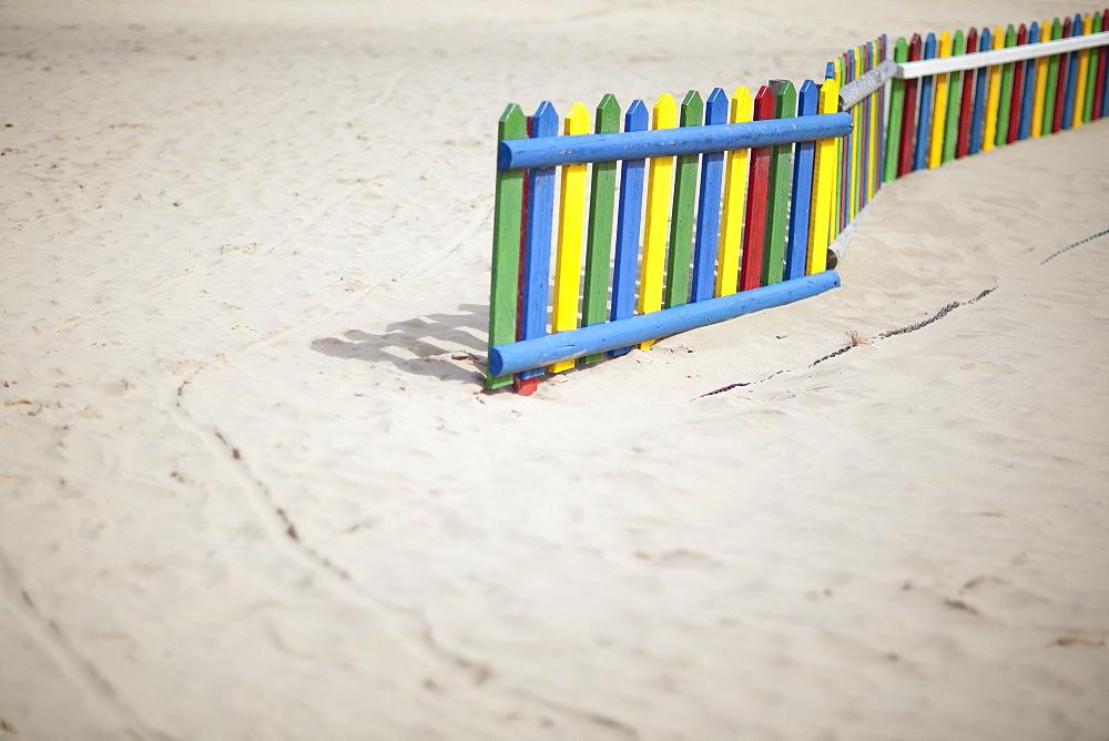 United Kingdom, England, Colorful fence on beach
