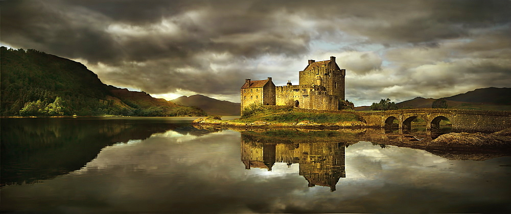 United Kingdom, Scotland, Medieval castle reflecting in lake