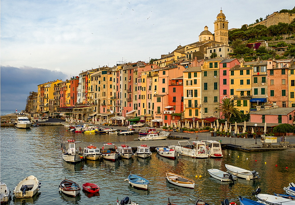 Italy, Cinque Terra, Boats in harbor with town in background