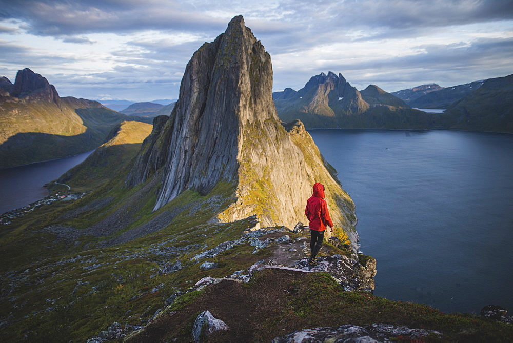 Norway, Senja, Man standing near Segla mountain