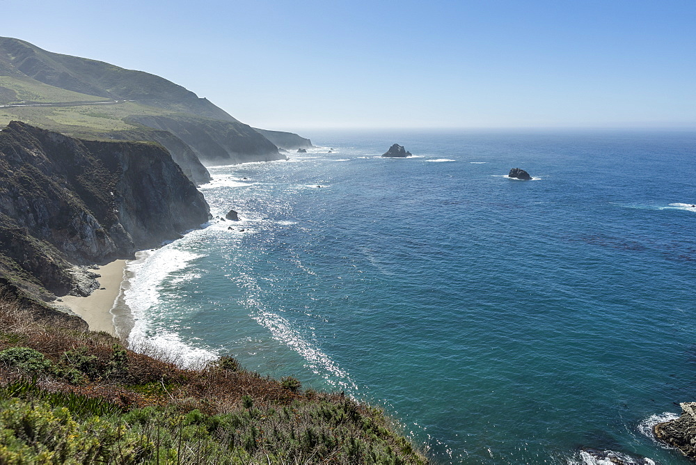 USA, California, Big Sur, Seascape with cliffs and beach on sunny day