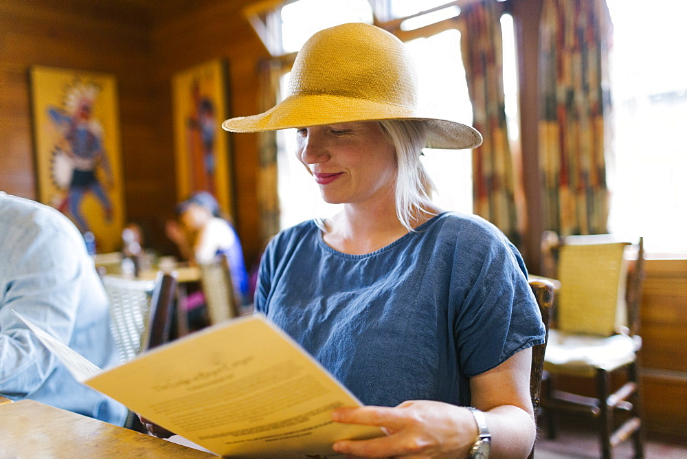 USA, Utah, Bryce Canyon, Woman looking at menu in restaurant
