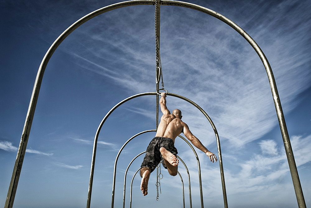 Man exercising on gymnastics rings