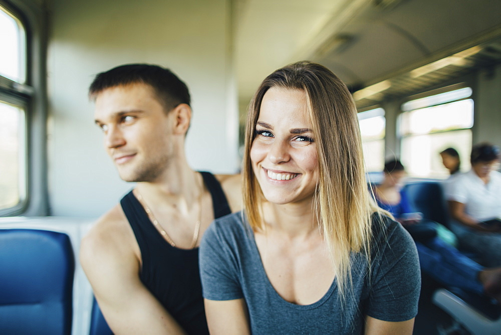 Young couple in train