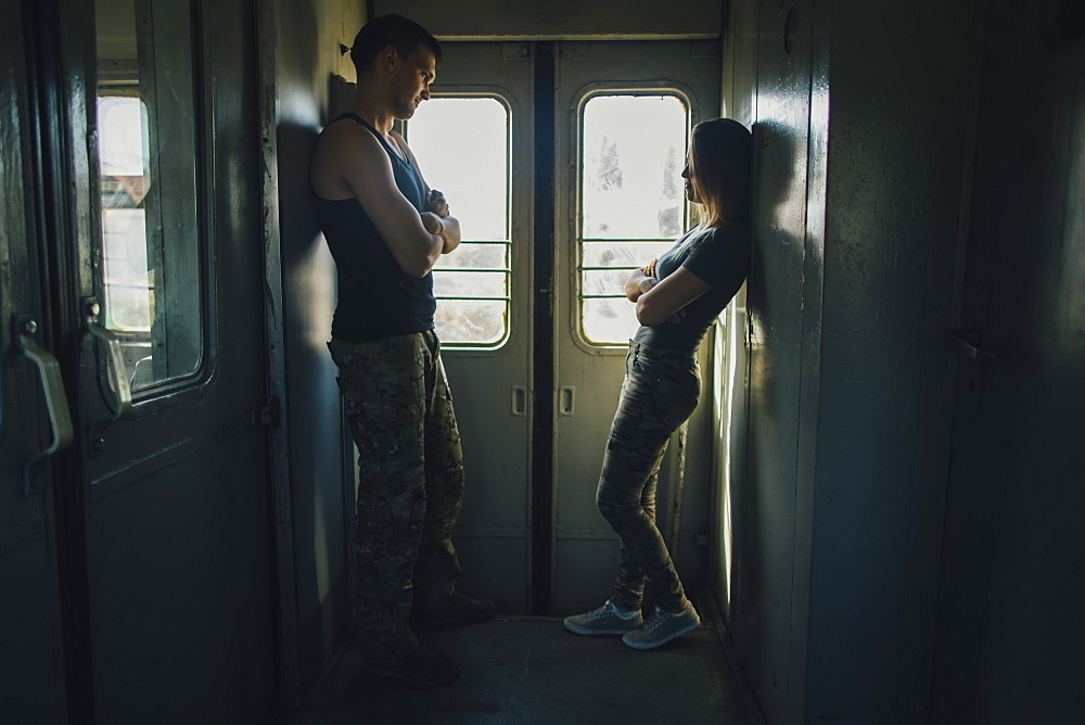 Young couple standing in train