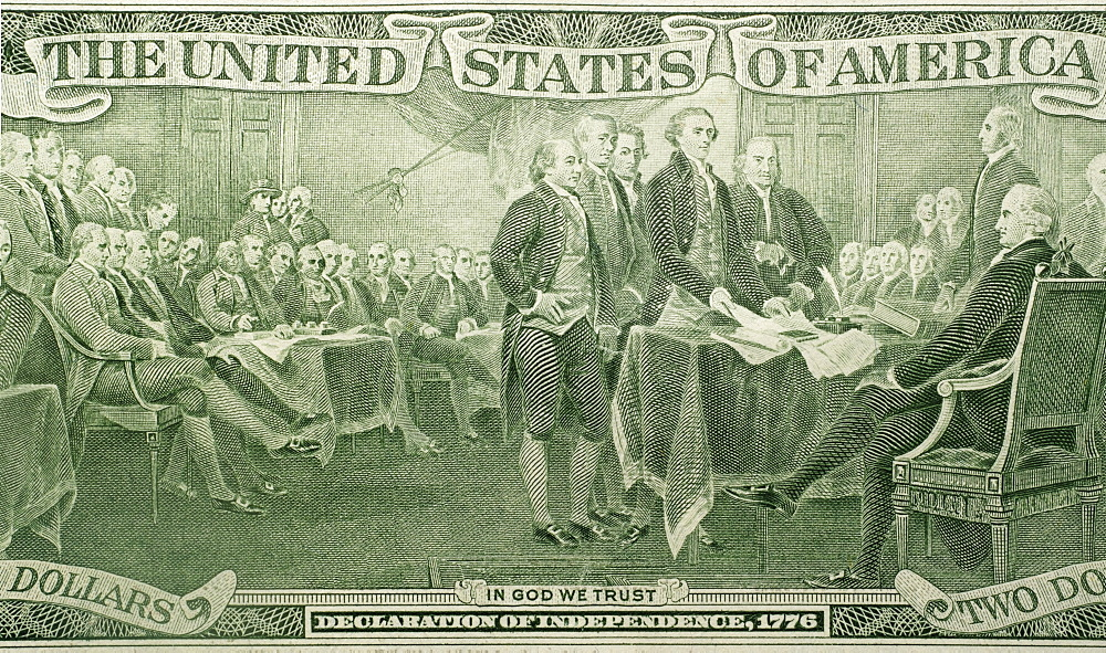 US paper bill with declaration of independence scene