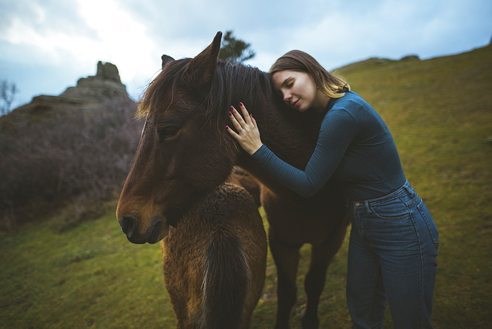 Ukraine, Crimea, Young woman embracing Icelandic horse - 1178-30076