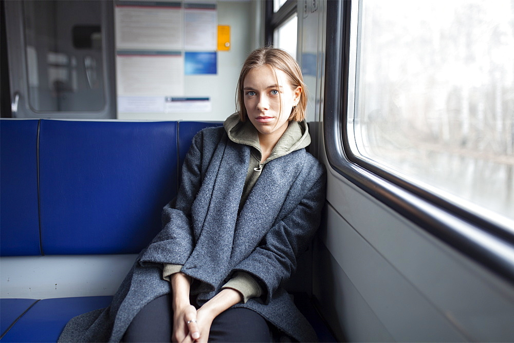 Portrait of young woman in train