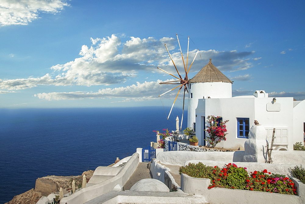 Greece, Oia, Santorini, Cyclades islands, Old windmill on waterfront