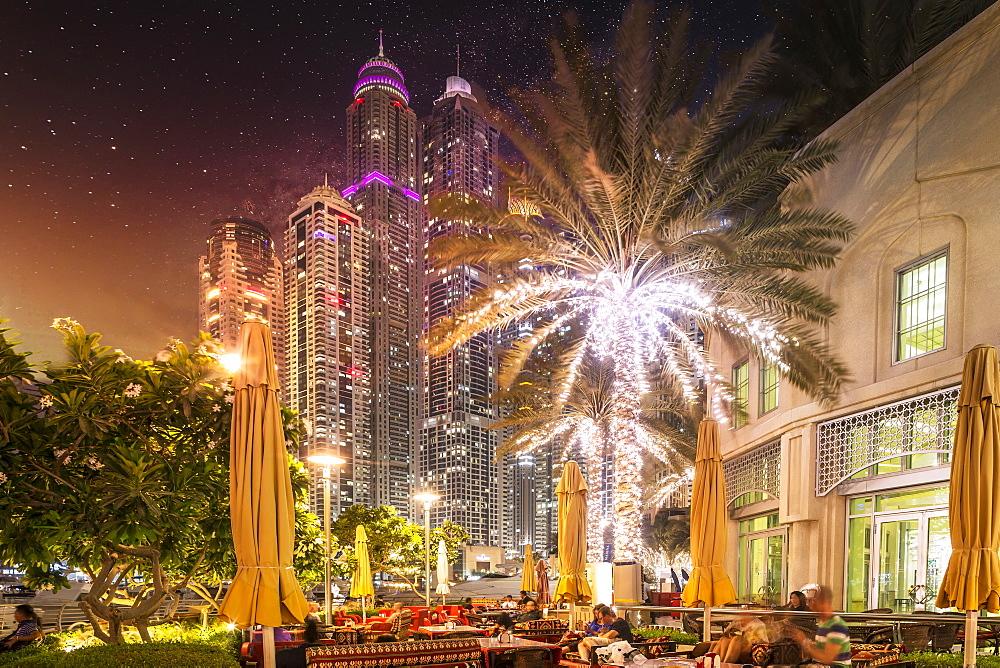 United Arab Emirates, Dubai, Illuminated skyscrapers at night