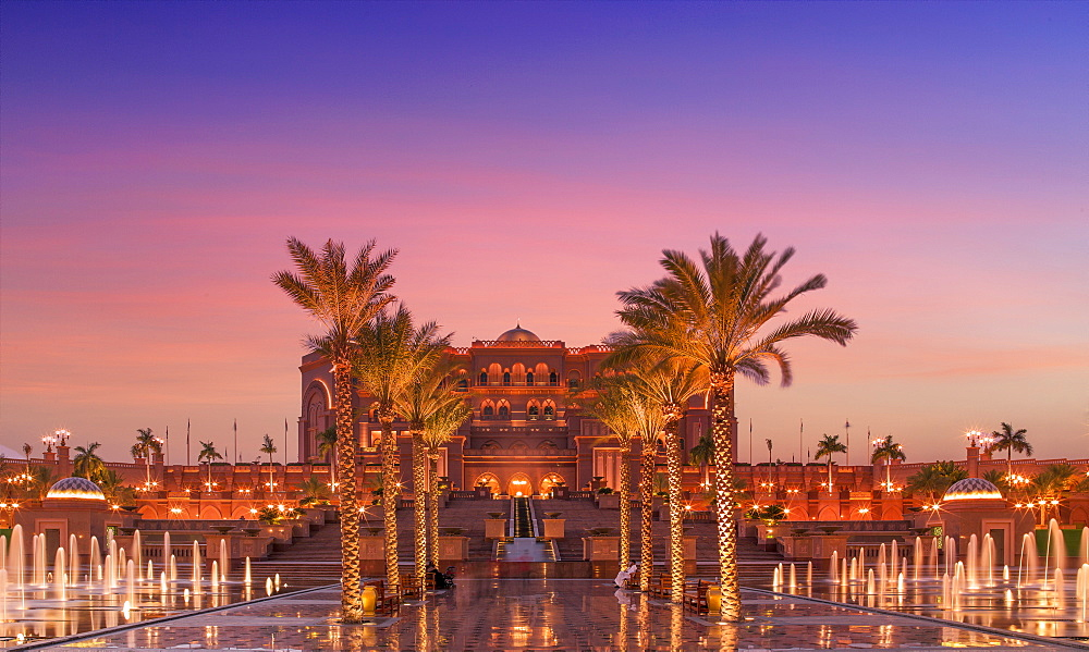 United Arab Emirates, Abu Dhabi, Palm trees and fountain in front of Hotel Emirates Palace