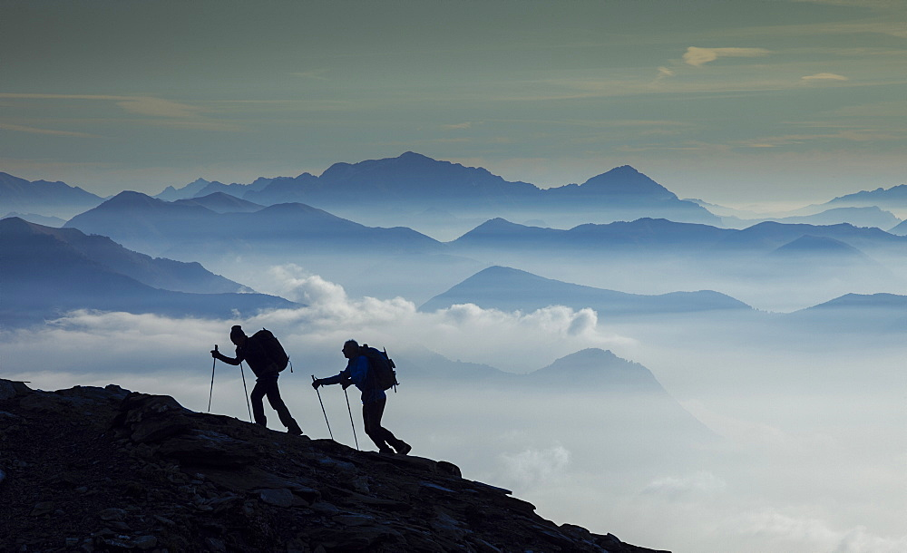 Italy, Piedmont, Alps, Monte Rosa, Silhouette of two climbers on mountain ridge