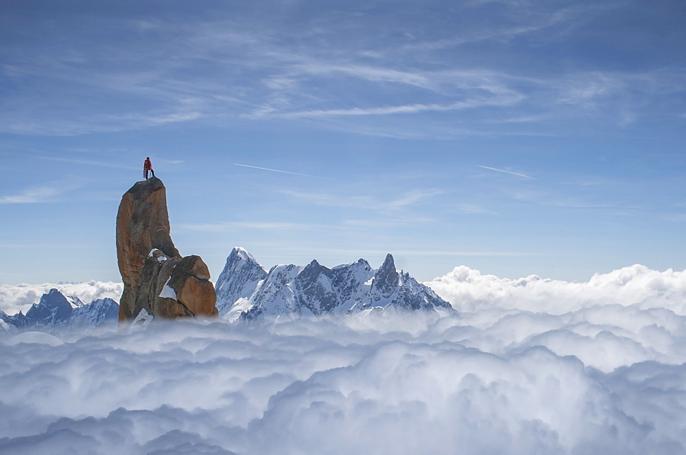 France, Chamonix, Mont Blanc, Aguille du midi, Climber standing on top of rock in mountains