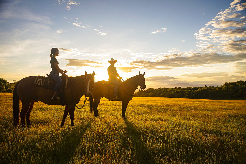 USA, Utah, Salem, Father and daughter (14-15) riding horses at sunset - 1178-30319