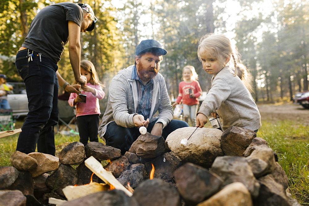 Family with three girls (2-3, 4-4, 6-7) roasting marshmallows above campfire, Wasatch-Cache National Forest - 1178-30368