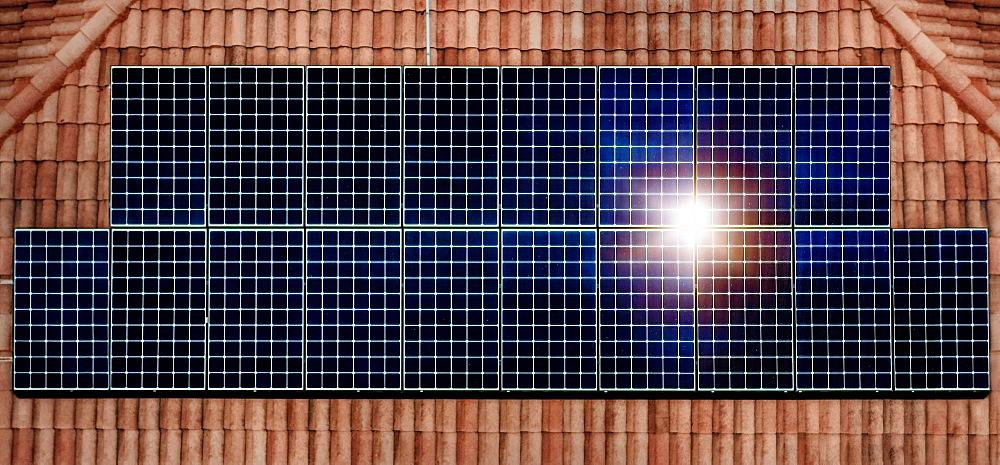 Solar panels reflecting sun on house roof