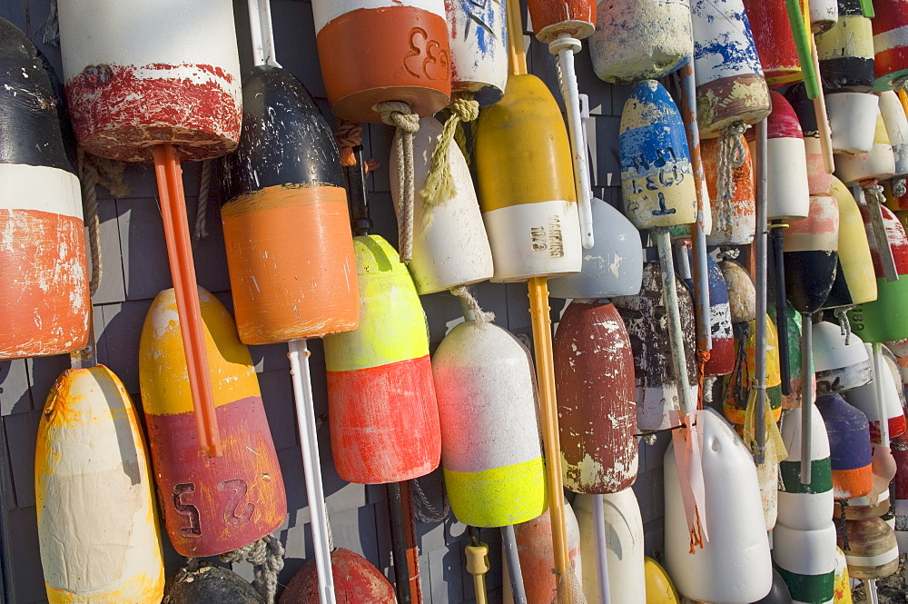 Colorful buoys hanging against wall