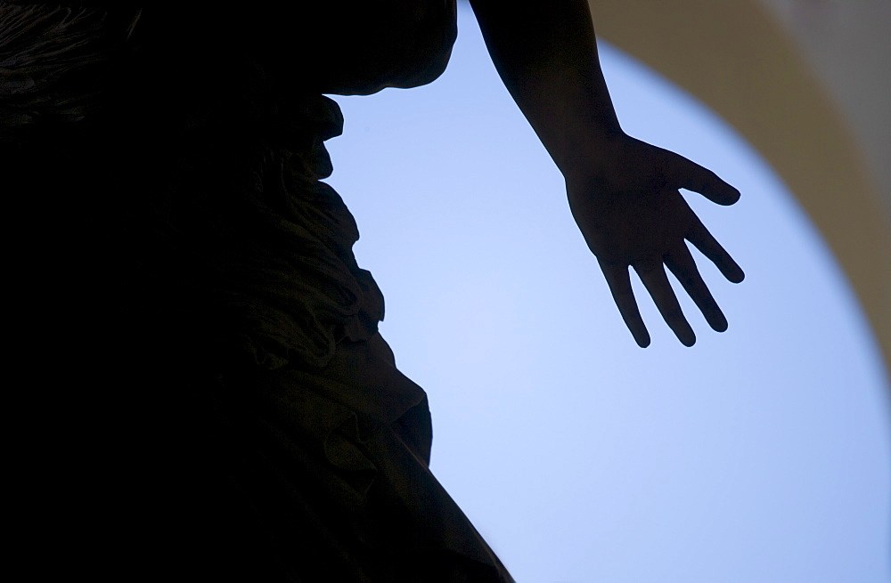 Silhouette of hand on statue Florence Italy