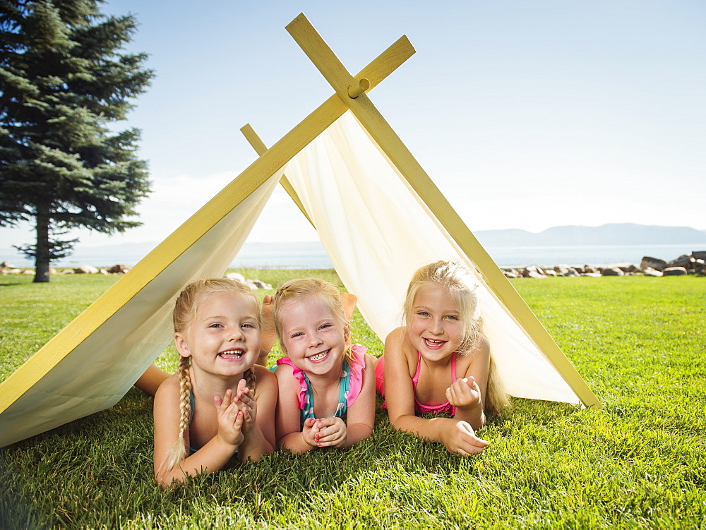 Three girls (2-3, 4-5) playing in tent, Garden City, Utah