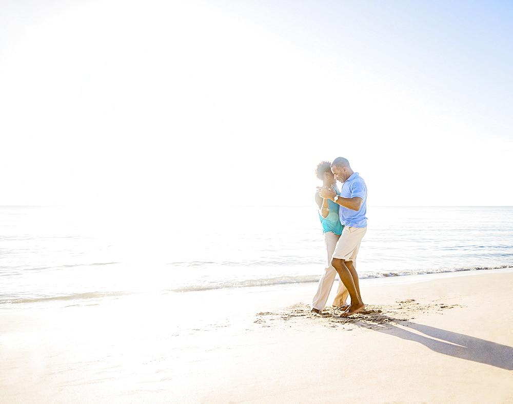 Mature couple dancing on beach