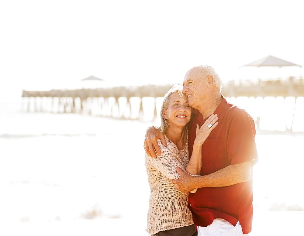 Senior couple embracing on beach, Jupiter, Florida