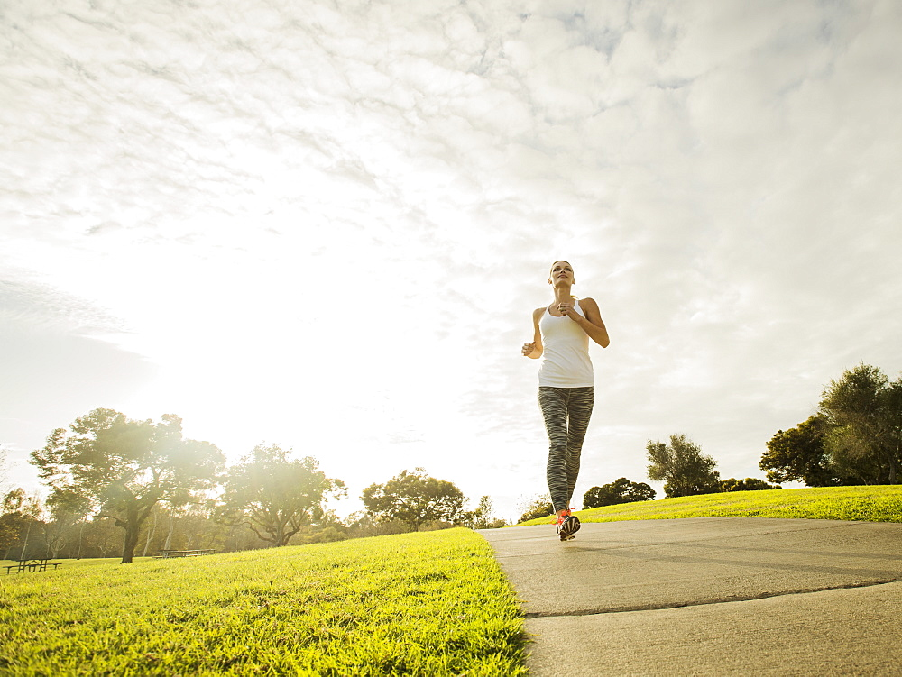 Woman running in park, Irvine, California